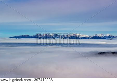 Sun Is Shining At Foggy Autumn Day On Top Of The Low Tatry Looking Into Mountain Tops Of The High Ta