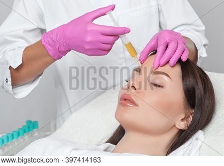 Cosmetologist Does Prp Therapy On The Face Of A Beautiful Woman In A Beauty Salon. There Is In Vitro