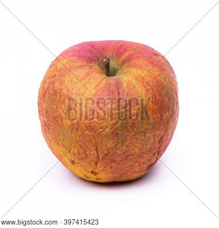 Old spoiled apple isolated on white background