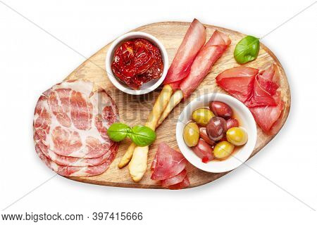 Cheese, meat and olives antipasto. Appetizer selection on wooden board. Top view flat lay. Isolated on white background
