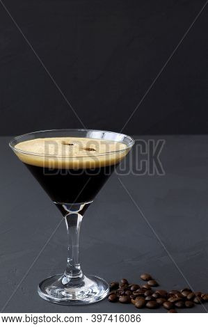 Espresso Martini Cocktails Garnished With Coffee Beans On Table. Martini Glass On A Black Background