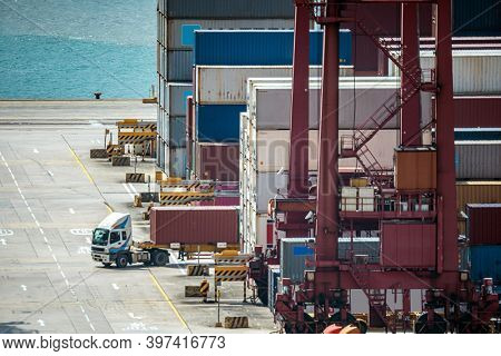 Working at Tshing yi Hong Kong Port for shipping and freight transportation and global business import and export background Noisy