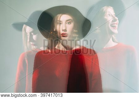 Motion Blur Female Portrait. Bipolar Disorder. Tranquility Mind. Defocused Silhouette Woman In Red S