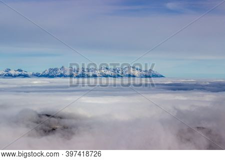 Sun Is Shining On Top Of The Low Tatry At Foggy Autumn Day Looking Into Mountain Tops Of The High Ta