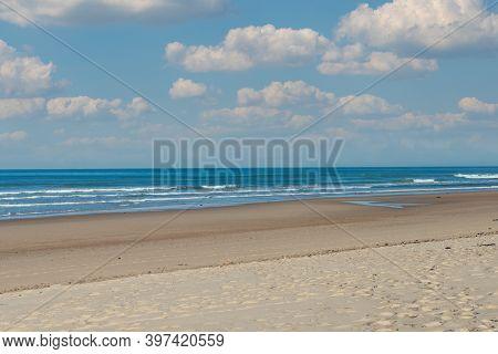 Small Waves On The Beach, The Blue Sky