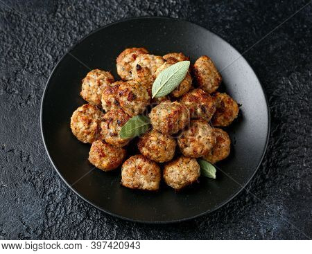 Pork Stuffing Meatballs With Sage And Onion In A Black Plate