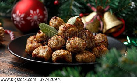 Christmas Pork Stuffing Meatballs With Sage And Onion. Decoration, Gifts, Green Tree Branch On Woode