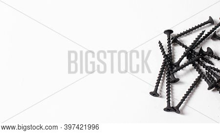 Self-cutters On A White Background Banner With Space For Text. Construction Tools, Self-tapping Scre
