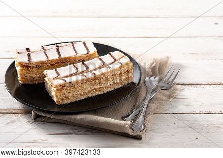 Millefoglie Or French Mille-feuille On White Wooden Table
