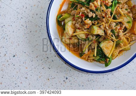 A Picture Of Hot And Spice Red Curry With Minced Pork And Vegetables Such As Small Eggplant, Fingerr