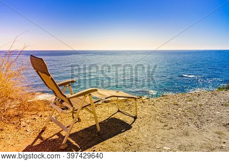 Empty Folding Camp Chair Outdoor On Beach. Holidays Relaxation On Trip. Vacation In The Camping, Spa
