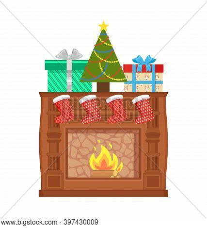Glowing Fireplace Decorated With Santa Socks And Colorful Gift Boxes Wrapped With Ribbon And Christm