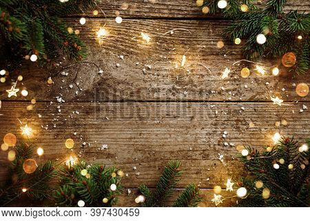 Merry Christmas Frame Made Of Christmas Decorations, Fir Branches, Spruce, Lights Garland, Snowflake