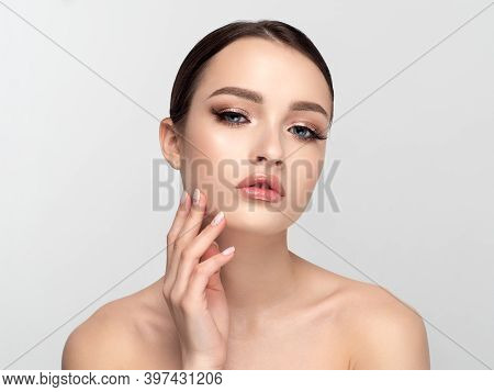 Portrait Of Young Beautiful Caucasian Woman Touching Her Face. Cleaning Skin, Spa Therapy, Skincare