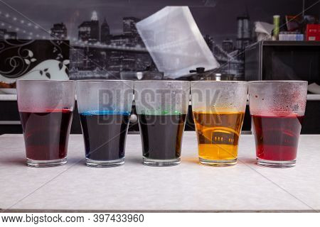Concentrated Food Coloring Of Different Colors Diluted With Boiling Water - Blue Yellow Green Red An