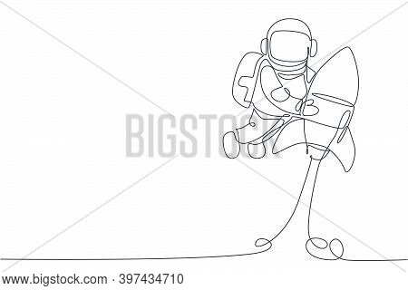One Single Line Drawing Of Astronaut In Spacesuit Floating And Discovering Deep Space While Holding