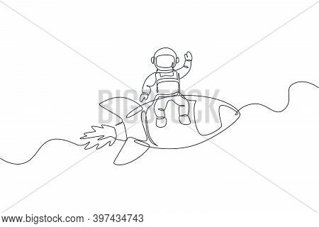 One Continuous Line Drawing Of Spaceman Astronaut Waving Hand And Sit On Flying Rocket. Cosmonaut Ex
