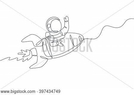 Single Continuous Line Drawing Of Astronaut In Spacesuit Waving Hand At Outer Space With Rocket Spac