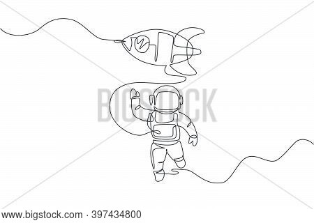 One Single Line Drawing Of Astronaut In Spacesuit Waving Hand And Discovering Deep Space With Rocket