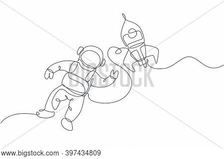 One Single Line Drawing Of Astronaut In Spacesuit Floating And Discovering Deep Space With Rocket Sp