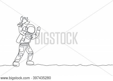 One Single Line Drawing Of Spaceman Astronaut Holding Trophy On Moon Surface, Cosmic Galaxy Vector I