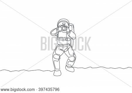 Single Continuous Line Drawing Astronaut Doing Photography With Dslr Camera In Moon Surface. Having