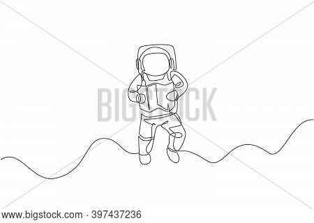 Single Continuous Line Drawing Floating Science Astronaut In Spacewalk Reading Map Navigator. Fantas