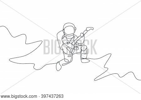 One Continuous Line Drawing Of Astronaut With Spacesuit Playing Acoustic Guitar In Galaxy Universe.