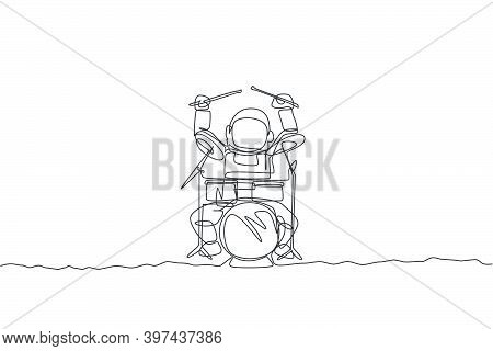 One Continuous Line Drawing Of Astronaut Drummer With Spacesuit Playing Drum In Moon Surface. Outer