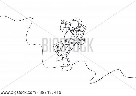 One Continuous Line Drawing Of Astronaut Singer With Spacesuit Singing A Song In Galaxy Universe. Ou