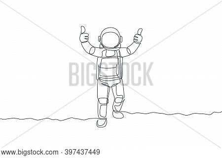 One Continuous Line Drawing Young Spaceman On Spacesuit Giving Thumbs Up Gesture In Moon Surface. As