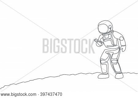 One Single Line Drawing Of Cosmonaut  In Moon Surface Make A Call To Family In Earth With Smartphone