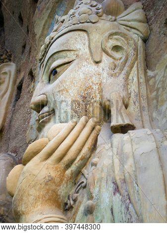 Stone Bodhisattva Statue At The Maijishan Caves In Gansu, China.