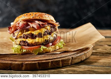 A Large Mouth-watering Burger With Grilled Beef Patty And Fresh Vegetables. Tasty American Cheesebur