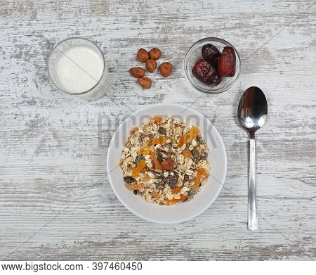 Healthy Mix Of Muesli With Dates In Glass Bowl Top View