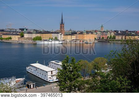 City Embankment, Ships On The Water, The Old City, May Sunny Day. Stockholm, Sweden.