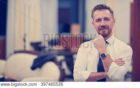 Portrait of smiling ceo at modern office in stylish suit