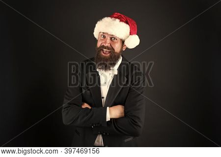 Man Bearded Hipster Wear Santa Hat. Christmas Spirit Concept. Corporate Holiday Party Ideas. Corpora