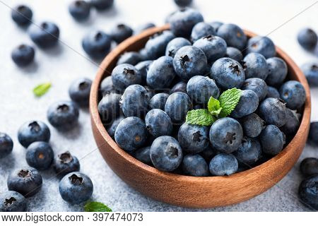 Pile Of Blueberries In A Wooden Bowl. Organic Juicy Blueberries