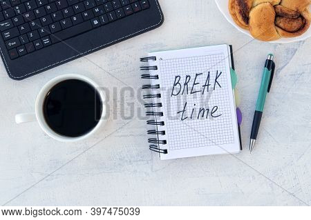 Break Time. Concept Time Off. Words Break Time In Notebook On The Working Table With Cup Of Coffee A