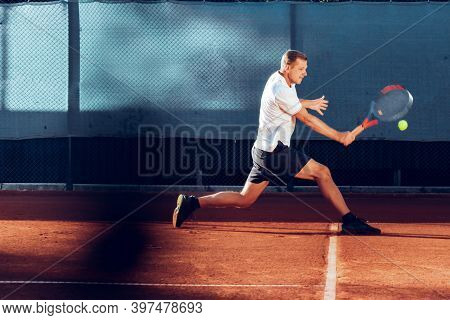 Proffesional Tennis Player Beats Off A Ball During Match