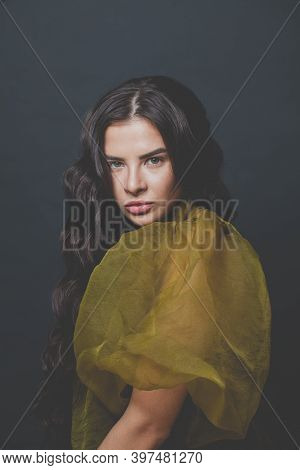 Pretty Brunette Woman Fashion Model With Long Healthy Curly Hairstyle On Black Background