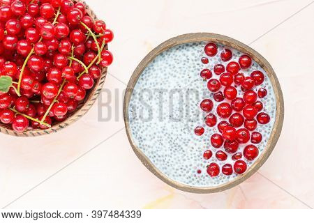 Fresh Red Currant Berries And Overnight Chia Seed Pudding In A Coconut Bowl. Close Up, Top View, Fla