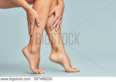 Cropped Shot Of A Woman Touching Her Legs With Smooth, Silky And Soft Skin After Making A Depilation