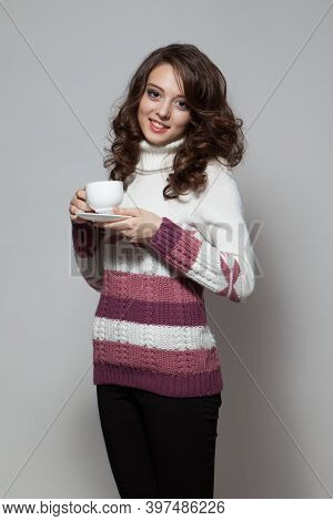 Young Brunette Woman Holding Cup Of Hot Tea.