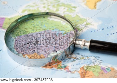 Bangkok, Thailand - November 01, 2020 Usa, America, Magnifying Glass Close Up With Colorful World Ma