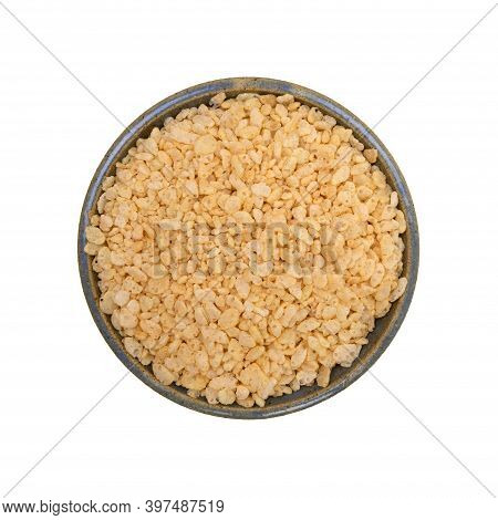 Top View Of A Stoneware Bowl Filled With Crispy Rice Breakfast Cereal Isolated On A White Background