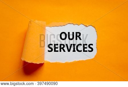 Our Services Symbol. The Words 'our Services' Appearing Behind Torn Orange Paper. Beautiful Backgrou
