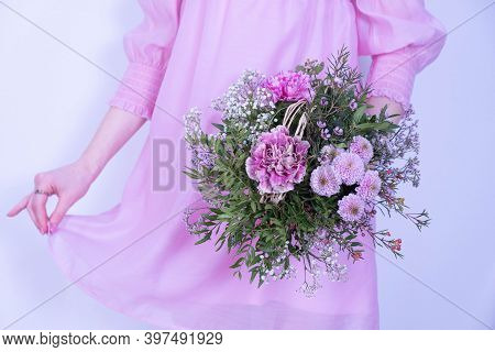 Bouquet Of Festive Flowers And A Young Girl In A Pink Dress On A White Background