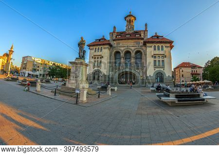 Constanta,romania-july 15, 2020:ovidiu Square In The Historic Center.in Front Of The Former Building